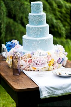 incredible pale blue cake with handwork filigree.  The flower garland around the bottom sets the whole thing off - just spectacular!