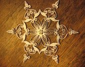 Quilled filigree paper snowflake