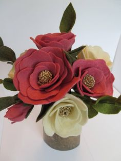 Tsubaki (Camellia) bouquet. This beautiful no-maintenance felt flower bouquet make a lovely gift or treat for yourself. These felt flowers are handmade, petal by petal, and placed on a wrapped wire stem. The flowers are in raspberry pink and white with gold glitter center, adding a touch