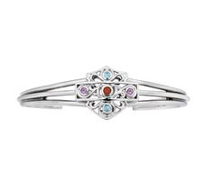 The Harley-Davidson® Women's Stain Glass Bracelet features genuine amethyst, garnet, and blue topaz gemstones set into a filigree designed Bar & Shield®. The sterling silver bracelet is a beautiful way to show off your love for all things Harley®. MOD Jewelry.
