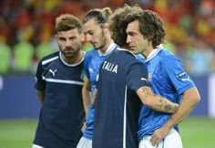 Italian midfielder Andrea Pirlo (R) is comforted by teammate after the Euro 2012 football championships final match Spain vs Italy on July 1, 2012 at the Olympic Stadium in Kiev. Spain won 4-0.