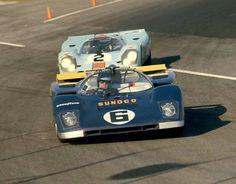 Daytona, 1971: Mark Donohue in his Penske Ferrari 512M followed by eventual winner Pedro Rodriguez in his Gulf Porsche 917K. Donohue and David Hobbs had the fastest car, but were rear-ended in a late-night accident. They eventually finished third. This was the end of an era for the 917 and 512. The FIA had outlawed the big 5-liter cars for the 1972 season instead restricted all cars to 3-liters.