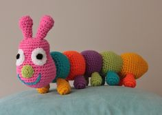 Elaine J. designed our new KAS mascot - the Cuddlebug, This one made by Anneke  Free pattern at www.knit-a-square.com Knitting For Charity, October 2014, Crochet For Beginners, Color Stripes, Vulnerability, Free Pattern, Knit Crochet, Dinosaur Stuffed Animal, Colours