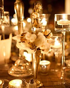 Warm up winter centerpieces with cotton. We love the cozy texture it adds to these white candlelit arrangements.