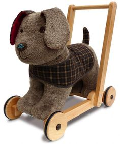 This beautiful traditional toy Percy Pup Push Along is both a ride on and a walker Built on a solid wooden frame with a high quality fabric body
