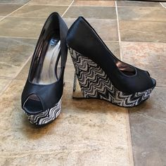 Amazing Platform Wedges Brand new, never worn! Comes with box. Excellent condition! 4.5 inch heel and reflective on the heel. Deb Shoes Wedges