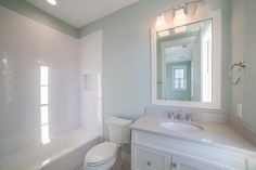 Relaxing Guest Bathroom | White Serene Bathroom | Bathroom Inspiration | Southern Style | Vacation Real Estate Bluffton, South Carolina