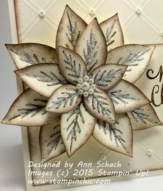 Stampin' Up!'s Reason for the Season stamp set and the Festive Flower Builder Punch were used to create this holiday card.