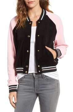 Look like an athlete and stay super cozy in this boldly color-blocked and sweetly styled velour track jacket finished with glistening snaps by Juicy Couture.