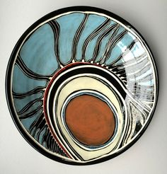 """Penny Evans, """" Design work on my ceramics reference my Kamilaroi/Goomeroi cultural heritage in combination with my unique and evolving graphic style. The technique of sgraffito is a strong feature of the ware and links to Kamilaroi/Goomeroi men's traditions of carving into tree, weapons, utensils as well as ground carving for ceremonial purposes, communications and storytelling.  2D mixed media works examine more recent histories as opposed to narratives connecting culture to country."""""""