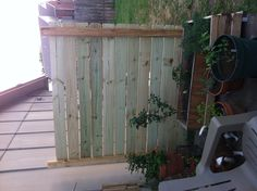 Cheap and easy privacy fence to block the apartments behind our home.