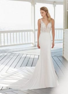 Rosa Clara Catania has a beautiful fitted lace bodice and an extravagant crepe skirt and long train. Try Catania at Morgan Davies Hitchin