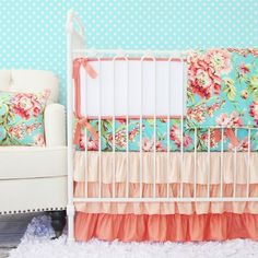 Aqua and pink make for an adorable little girl's nursery! We love the floral pattern on the bedding!