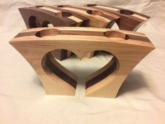 These are heart shaped tea light candle holders made from reclaimed wood. Wood Shop Projects, Small Wood Projects, Modern Candle Holders, Tealight Candle Holders, Small Woodworking Projects, Woodworking Crafts, Woodworking Candle Holder, Wood Fish, Wooden Diy