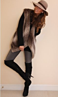 fierce 70s! black high boots + jeans + fur vest + boho floppy hat