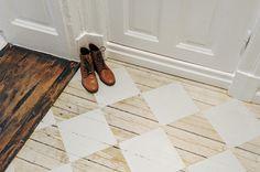 white diamonds painted over wood flooring