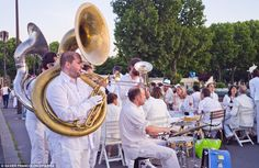 Party atmosphere: A brass band provide some background music, dressed in white of course