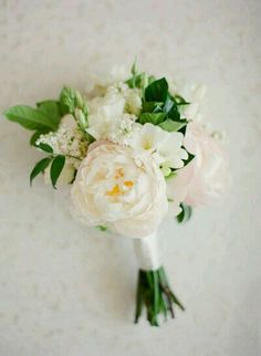 I really like this bouquet. It's small, not too round/ tight, has ivory/ blush flowers, the green is dark, and has ivory ribbon.