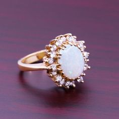 I am still accepting wedding gifts! ;)  Classic Vintage White Opal Ring With Diamonds by AviantiJewelry, $5769.00