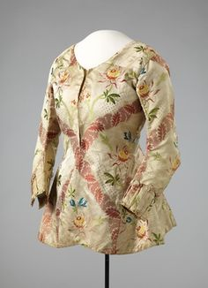 Bodice, 1750 (material) made c.1770s, Norway, Hand Woven binding patterned silk fabric with brosjert touches. Lining of hand-woven silk fabric in plain weave . Metal Hooks and clasps . Hand Stitching .