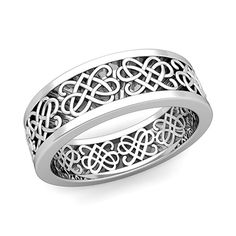 Celtic Heart Knot Wedding Band in 14k Gold Comfort Fit Ring, 7mm. This wedding band showcases intricate Celtic Heart Knot design in a 14k gold band. The striking ring design makes it perfect as a wedding ring or anniversary ring for men and women.