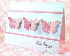 handmade greeting card ... white and pink ... clean and simle ... trio of die cut and shaped butterflies on a matted band ... lovely card!