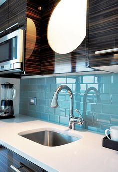 This is the high gloss exotic wood cabinetry I want!  Sky Blue Glass Tile Kitchen Backsplash