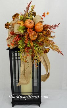 Fall floral swag, fall lantern swag, lantern swag, fall decor, fall floral, lantern topper, fall decor, fall table decor, fall swag Our floral swags are a great way to dress up a lantern, candlestick, wreath, banister, and more! This swag is made with burlap ribbons, pumpkins, various flowers, and various greens. They are versatile and can be used in so many different ways! The swag measures approx. 10 W x 17L. They simply attach with wired chenille. Lantern is NOT included in sale…