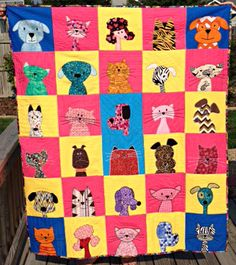 Melinda's terrific quilt combining Cats and Dogs from Shiny Happy World.