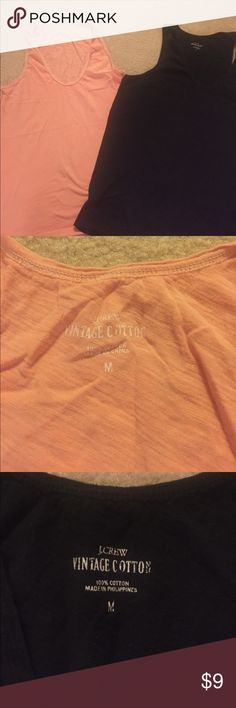 Jcrew vintage cotton sleeveless shirts 2 J.Crew vintage cotton sleeveless tshirts- orange and black. The black has a small hole in the front but overall both in good condition! J. Crew Tops Tank Tops