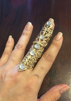 Shield Full finger ring, vintage style filigree,gold color metal, decorated with clear crystals adjustable by pickapicka on Etsy https://www.etsy.com/listing/219283165/shield-full-finger-ring-vintage-style
