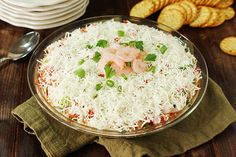 Layer cocktail sauce, shrimp, green onions, tomato and more for this shimp layer dip. Enjoy seven layers of flavor on chips or crackers!