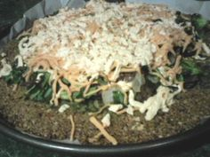 Sunflower and pumpkin seed-based pizza crust topped with veggies and Daiya cheese