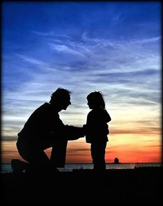 Dad and his daughter silhouette.