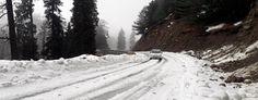 Mughal Road experienced fresh snowfall on Saturday. -Excelsior/Younis Khaliq