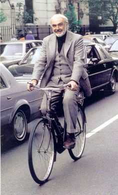 Sean Connery riding a bicycle