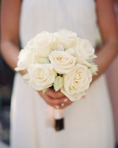 Cream colored roses for bridesmaids who would wear black bridesmaids dresses