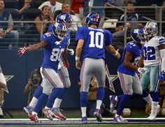 Giants vs. Cowboys - Manning and Cruz celebrate a victory as they beat the 'Boys 20-19 to take a 1-0 start. They'll meet again in New Jersey in December. (9/11/16)