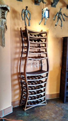 Copyright and patent pending.  This wine rack is made from large Napa valley wine barrels that have been carefully taken apart and fashioned into a fully functional wine rack to hold the wine it just held. Completely 100% recycled and salvaged wine barrels.  Each of these wine barrel racks are made to order by us and are constructed using screws & wooden dowels to ensure a lifetime of enjoyment.  This rack is narrow enough to be in a kitchen while still holding a large selection of wine…