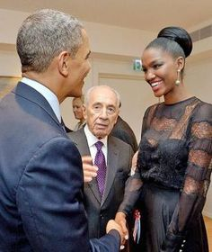 President Barack Obama shakes hands with Yityish Aynaw, a 21-year old Ethiopian-Israeli who won Israel's Miss Israel national beauty pageant, at the President's Residence in Jerusalem on March 21, 2013.