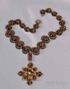 Rare Prototype Necklace, Miriam Haskell, c. 1960, designed and executed by Robert F. Clark, the necklace of gilded metal domed links set with small bronze Venetian beads alternating with roses montees and centering a pate de verre bead, suspending a cross with prong-set strass, roses montees, and pate de verre beads, signed.  -  Note: Pictured in The Jewels of Miriam Haskell by Deanna Farneti Cera, p. 154. According to Robert F. Clark, this model was never put into production.