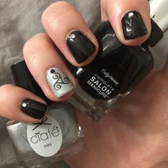 Sally Hansen Midnight in NY nails with Ciaté London House of Mirrors accent nail, plus MoYou London stamping from Gothic 02 plate and black & silver rhinestones. ~ Black and silver diamond nails
