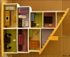 dollhouse furniture out of cardboard, glue, papermache. Doll house is out of boxes. Check out her blog for instructions.