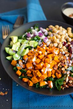 This Chopped Kale Power Salad with Lemon Tahini Dressing is the perfect salad to start the New Year with!  Eat it for lunch and you'll have energy all day!  Packed with healthy and delicious ingredients, including: sweet potato, chickpeas, almonds, avocado, cranberries and red onion!