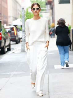 Lily Aldridge in a white J. Brand sweater, white Chloé pants, and white and tan Tabitha Simmons Alexa flats