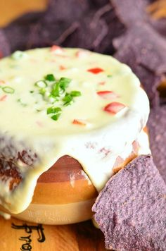 Finger-licking-good Homemade White Queso Dip. Spicy, cheesy dip made with two kinds of cheese, jalapenos, bell peppers and green onions. Awesome appetizer for a game day party. | from willcookforsmiles.com