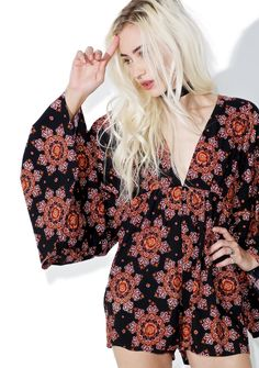 Motel Full Moon Playsuit is gunna draw the energy out of the skies, babe. This gorgeous playsuit features a soft 'n flowy black construction printed with beautiful burgundy floral medallions, voluminous kimono sleeves, sleek tailored shorts, and a plunging neckline.