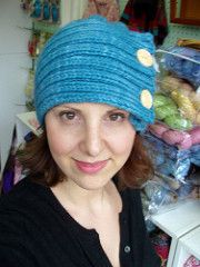 This hat is inspired by a pattern from the O-Wool yarn company that I helped a client with. I fell for the style, but the method, gauge, etc needed some refining. My hat is knit in a chunky/Bulky weight yarn and needles that are normally suitable for an Aran - this makes it dense and helps keep out the wind (I haven't gone up against any heavy winter winds yet but since I finished it my little head has not been touched by the big bad Canadian winter). The construction is fairly straight…