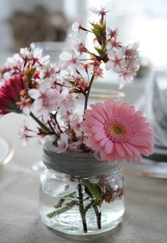 Jar with band full of spring flowers #gerbra #pink - Image via http://franciskasvakreverden.blogspot