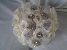 Pure white roses and jewelley bouquet